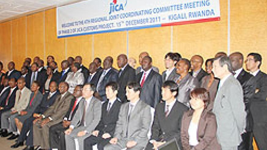 Members from the five East African Community partner states who participated in the meeting pose for a photo. The New Times / Grace Mugoya.