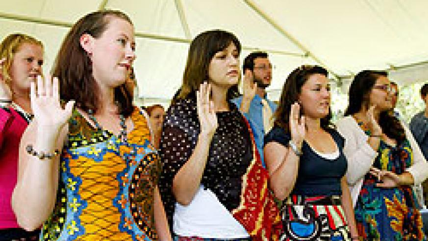 Peace Corps volunteers take the oath yesterday in Kigali. The New Times / Timothy Kisambira.
