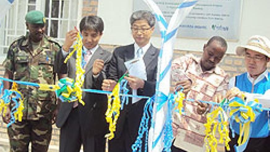 Korean Ambassador to Rwanda, Heon Lee(center) at  the opening of the centre.  The New Times / D. Sabiiti.