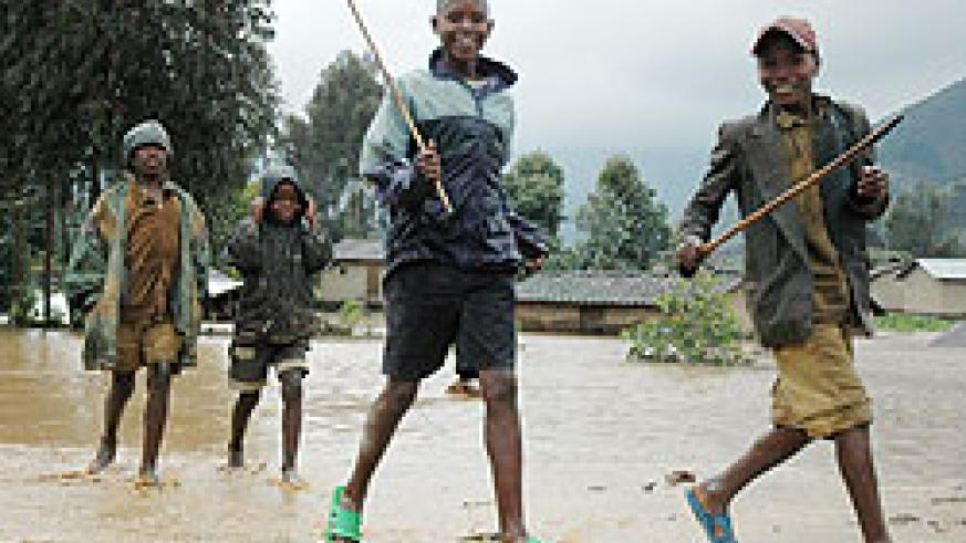 oung boys play in a flooded area in Rubavu District. Local authorities have been told to map out disaster-prone areas. The New Times File