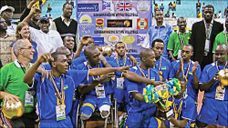 The national sitting volleyball team pose for a photo shortly after qualifying for next year's Paralympic Games in London. The New Times / File