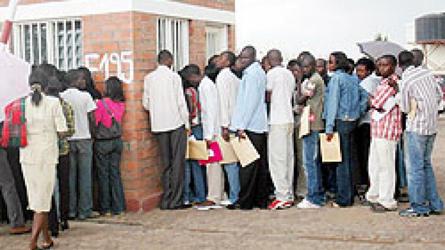 Jobseekers line up to submit their applications. Government hopes to significantly cut unemployment rate in the near future. The New Times / File.