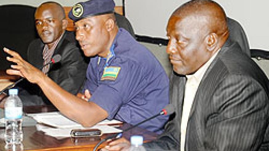 Chief of Police Operations,  Emmanuel  Butera (C), with Paterne Rwigema of the Ministry of Education (R) and the Executive Secretary of the National Youth Council, Alphonse Nkuranga, during the town hall meeting yesterday. The New Times/J.Mbanda.