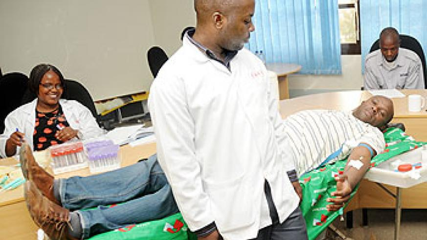 A man donating blood. The NewTimes/ File.