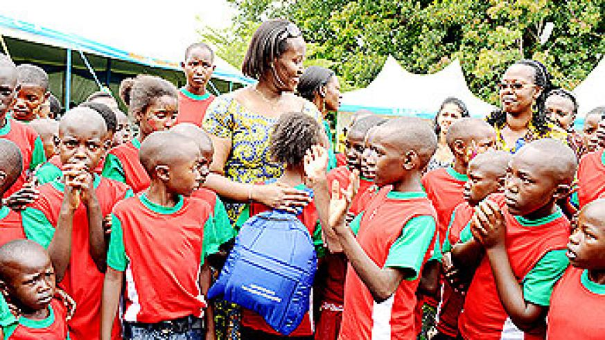 First Lady giving Christmas gifts to children who attended the Party.