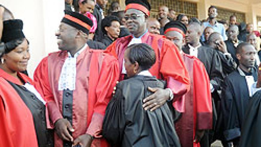 High Court president Johnston Businge congratulates the newly sworn in advocates yesterday. The New Times / J. Mbanda