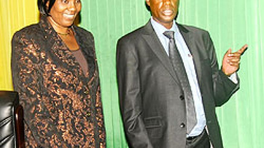 Defence Minister Gen. James Kabarebe (R) with Speaker Rose Mukantabana in Parliament (The New Times / John Mbanda).