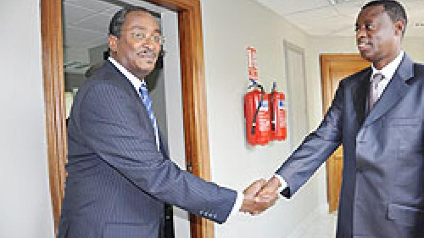 Defence Minister James Kabarebe (R) shakes hands with the new Sudanese Ambassador to Rwanda, Nasreldin Ahmed Walli after their meeting in Kigali yesterday.