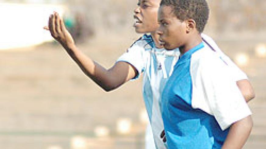 AS Kigali coach Grace Nyinawumuntu passing on tips to her players last season. (The New Times; File photo)