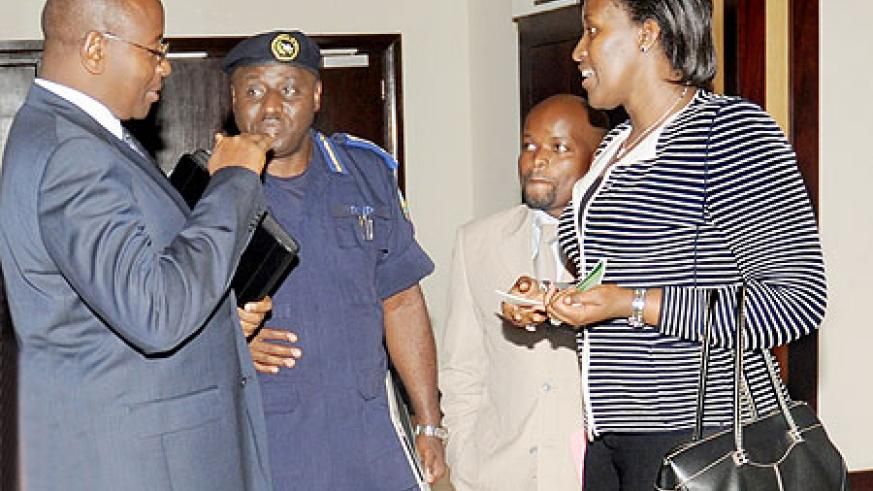 First Lady Mrs. Kagame (R), talks to IGP Gasana, Local Gov't Minister James Musoni (L) and Youth Minister, Jean Philbert Nsengimana, during the meeting on alcohol and drug abuse among the youth, yesterday. The New Times / J.Mbanda.