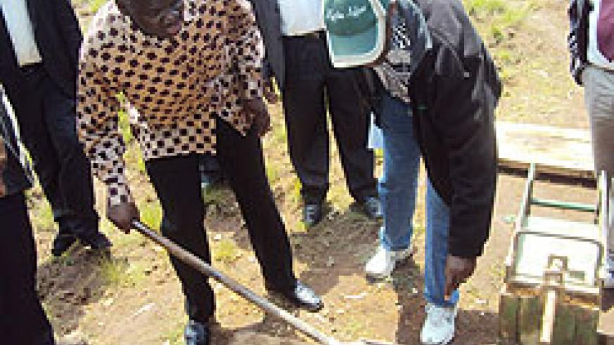 Minister Kamanzi uses a hand-brick-making machine. The New Times / J P Bucyensenge