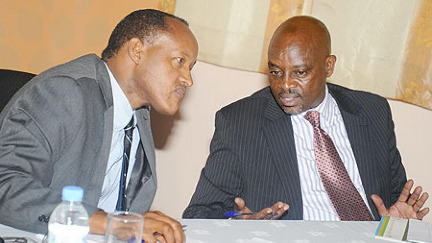 PSF Chairman Faustin Mbundu (L) with the Commissioner General of Rwanda Revenue Authority, Ben Kagarama at the forum yesterday . The New Times / J. Mbanda.