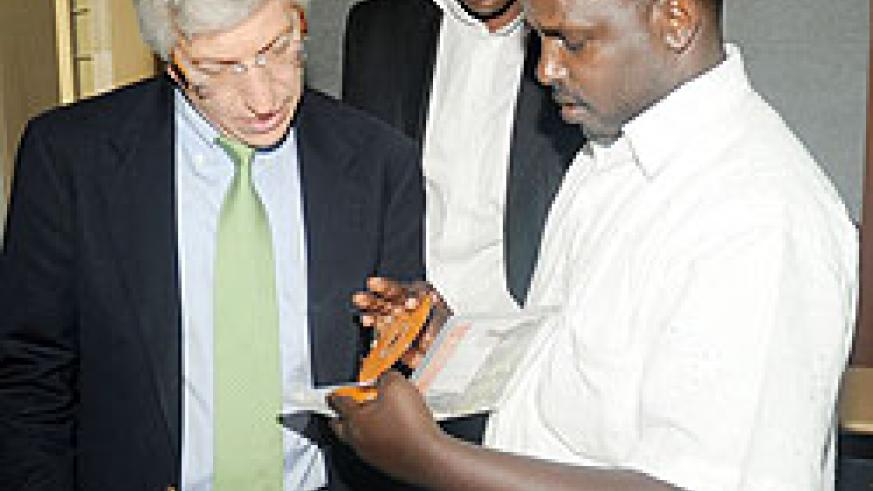 L-R; Solidworks Vice President David Stott, Eng. Diogene Mulindahabi and the Director of ICT in WDA David Mugume looking at the software. The New Times / John Mbanda.