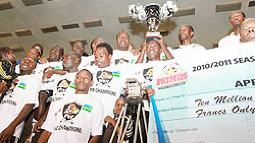 APR players posing with the 2010-11 Primus League trophy. The New Times / File