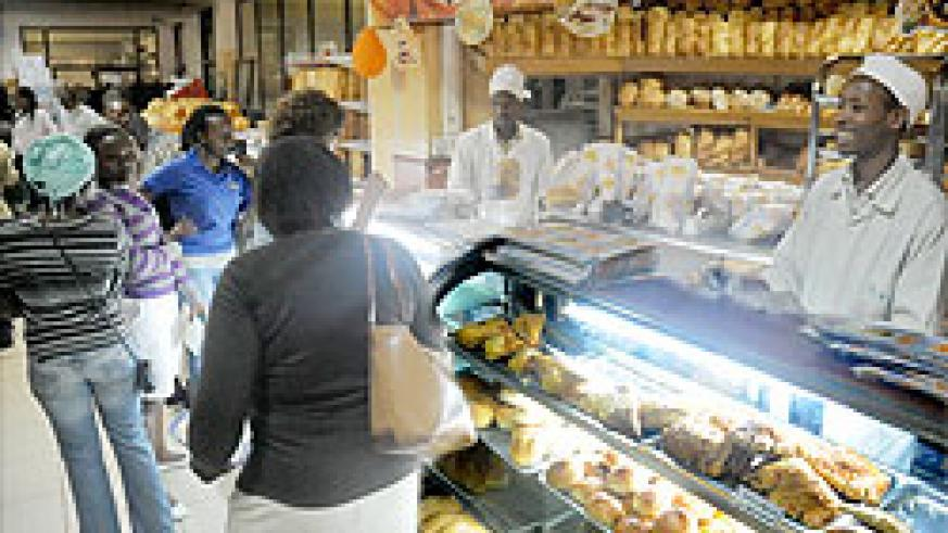 shoppers at Simba supermarket decided to offer a discount of 5 percent to attract more clients.The New Times / J. Mbanda.