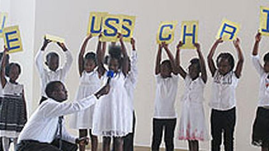 Children spell out JESUS CHRIST while explaining the meaning of each letter.
