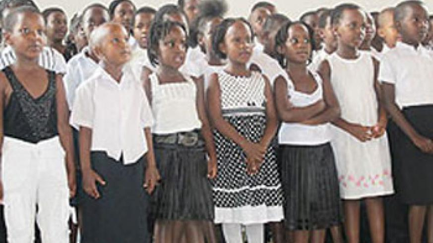 The children choir sings carols to the amazement of the crowd.