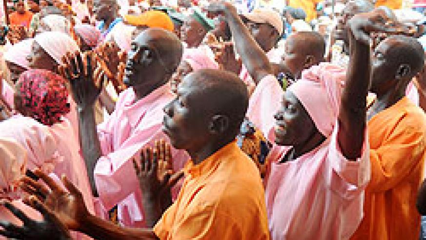 Nsinda Prison Inmates sing before some of them were released last month. The New Times / File.