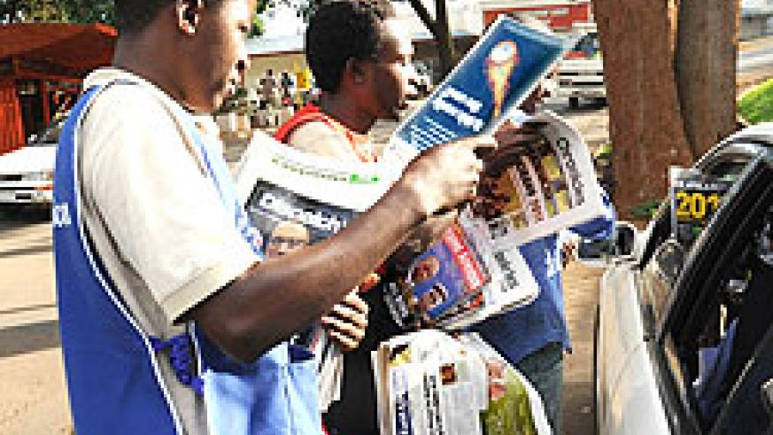 Newspaper vendors in Kigali. Parliamentarians are discussing media bills aimed at streamlining the profession. The New Times / John Mbanda.