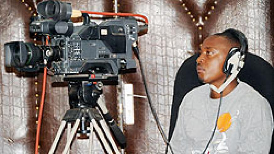 A TV cameraman captures a live discussion.Analogue will soon be phased out to pave way for digital TV transmissions.