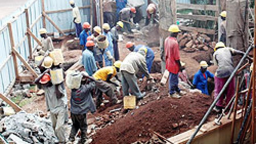 Workers at a construction site. Government intends to formulate a policy to ensure protection of employees at their workplaces. The New Times / File.