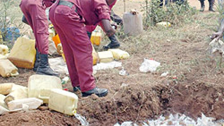 Local defence force destroy illicit brew. The New Times / File.