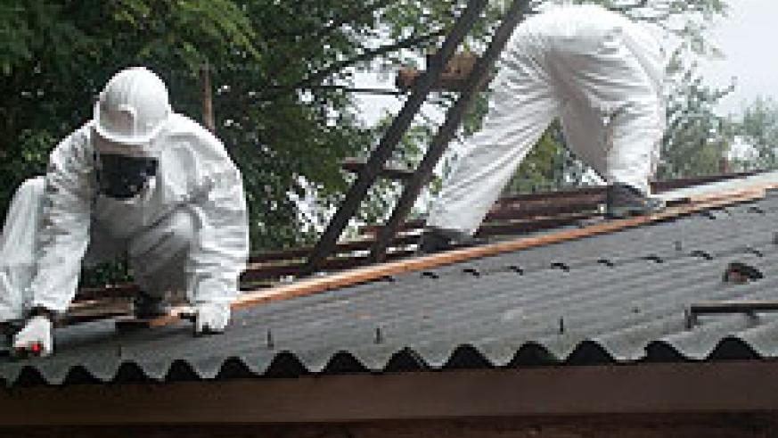 Removing asbestos requires proper clothing to avoid contamination. The New Times / Courtesy