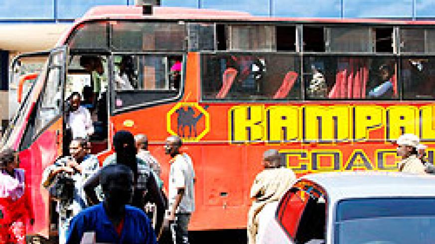 Passengers disembark from a bus from Kampala at Nyabugogo  yesterday. Bus companies cashed in on the festive season. The New Times / T.Kisambira