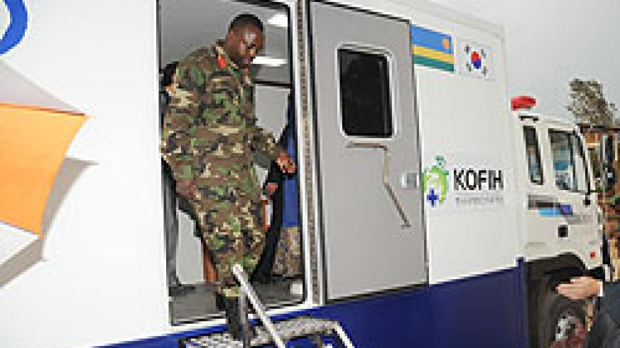 Kanombe Hospital Director, Col Ben Karenzi alights from one of  the mobile clinic vans. The facilities offer the same services rendered by referral hospitals.