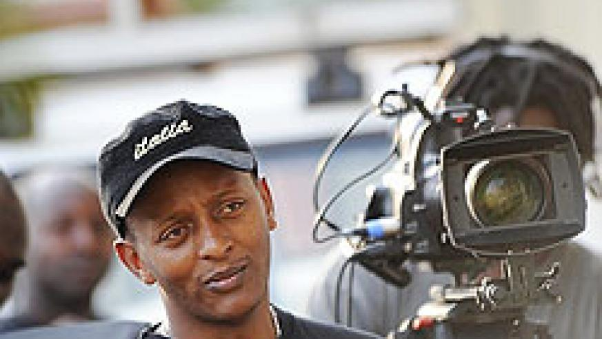 Eric Kabera behind the scenes during a film shoot.
