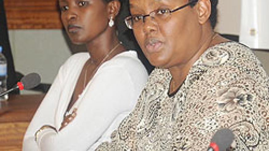 The Executive Secretary of the PSC Angelina Muganza (R) and Jacqueline Kamanzi, the in-charge of conflict management, at a town-hall meeting yesterday. The New Times / John Mbanda.