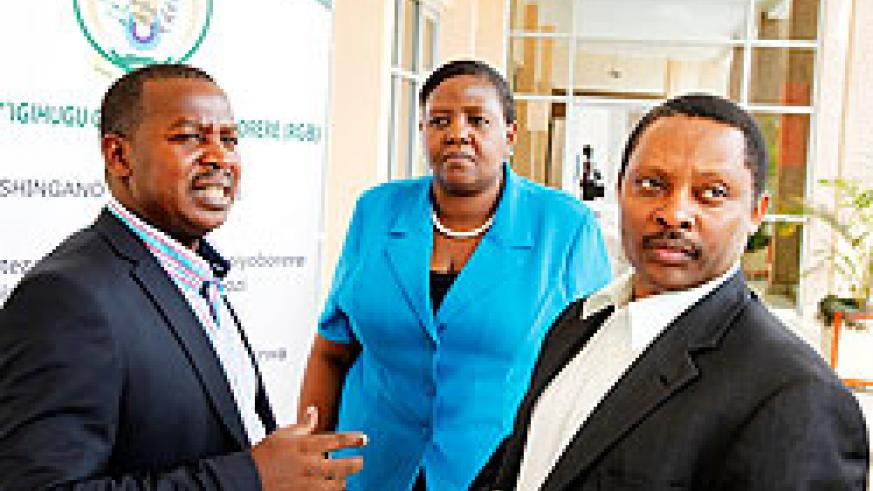 (L-R)Cyril Turatsinze, PS in MINALOC,  Amb. Fatuma Ndangiza, Deputy CEO  Rwanda Governance Board, and Prof. Anastase Shyaka, the Chief Executive Officer RGB chatting after a meeting  on Friday in Kigali. The New Times / File.