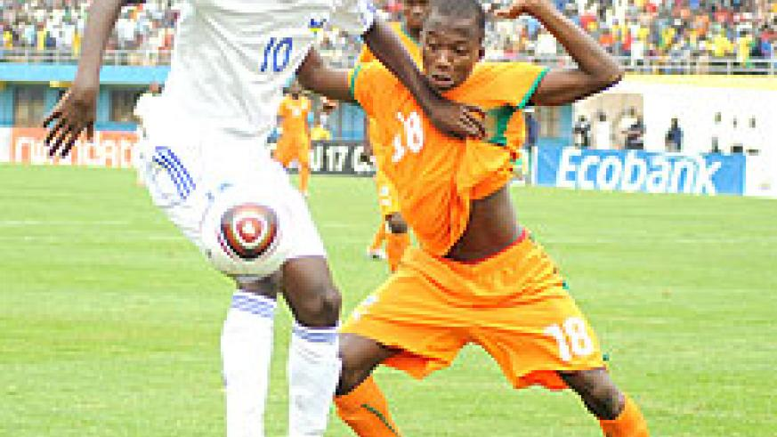 Andrew Buteera shields the ball against Ivory Coast in the Caf U-17 Championship early this year. He was one of Amavubi's top players in last year's Challenge Cup. The New Times / File