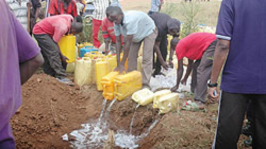 Police and residents destroy hundreds of litres of illicit brew intercepted in the past. The New Times / File.