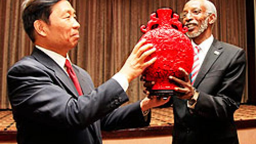 RPF Secretary General François Ngarambe, (R) receives a traditional Chinese Pot from Li Yuanchao, Member of the Political Bureau of the Communist Party of China, after their meeting at Kigali Serena Hotel yesterday. The New Times / Timothy Kisambira.