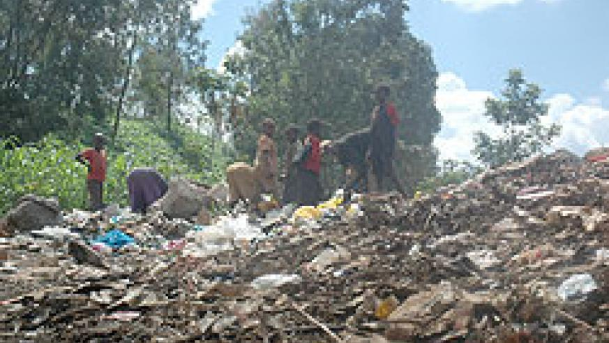 TO BE PHASED OUT; Children forage through a garbage heap at Nyanza landfill in Kigali. The New Times / File.