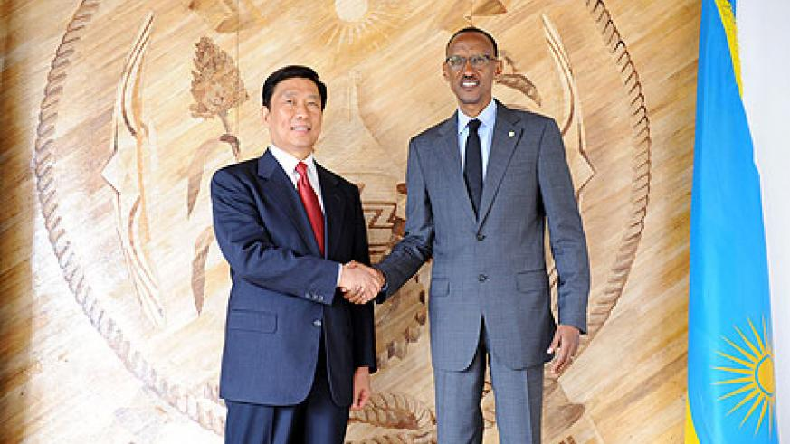President Kagame with Li Yuanchao, Member of CPC's Political Bureau and Secretariat, after their meeting yesterday. The New Times / Village Urugwiro.