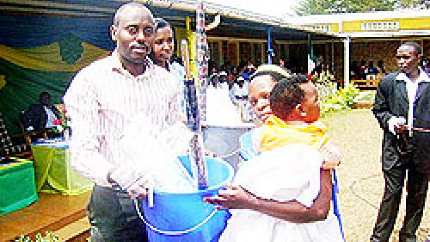 Ndagijimana rewards a mother as for observing antenatal care. The former was sacked for failing to ensure proper hygiene at the hospital. The New Times / File.