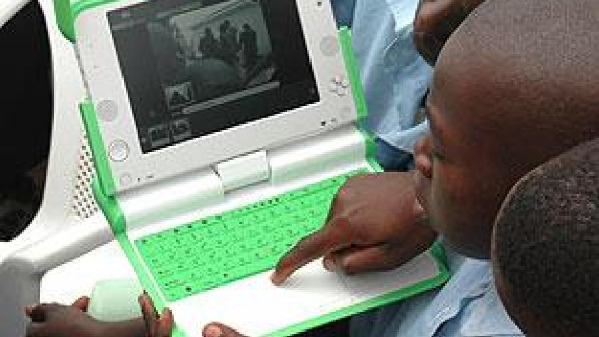 Primary School Pupils using a Laptop. Kigali considers Japan a potential partner to enhance the OLPC programme. The New Times / File