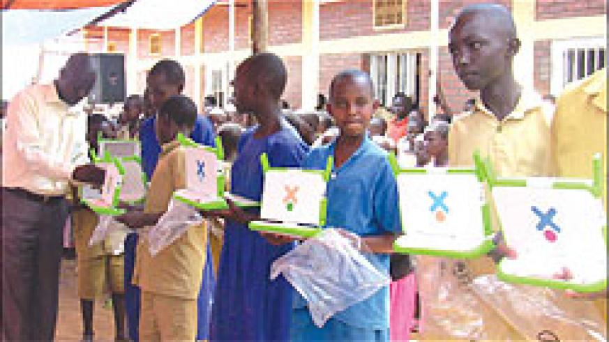 Mayange Primary School pupils receiving laptops. Education officials say indiscipline among students affects their performance. The New Times / File.