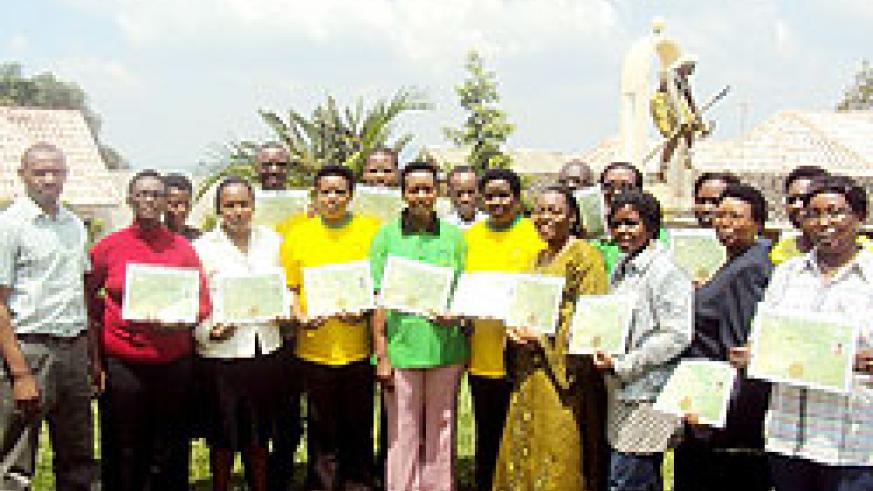 A group of the nurses and midwives pose for a  photo with their certificates. The New Times / Courtesy.