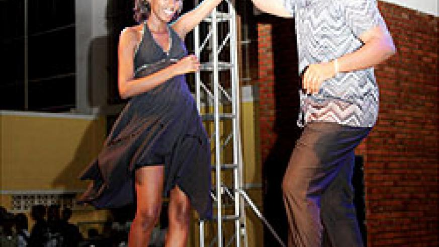 Mike Marorerwa on stage with  a Salsa co-dancer. The New Times / Flie.