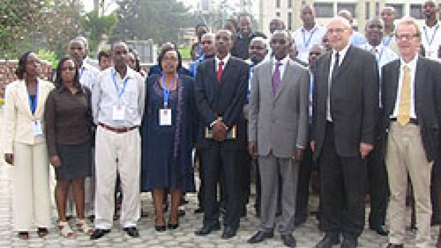 Rugege (3rd R) with ILPD staff members and  new students in  a group photo on Tuesday. The New Times / File