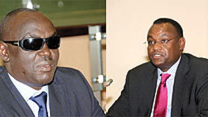 L-R: EALA legislator Dr James Ndahiro, EALA Speaker Abdurahim Abdi
