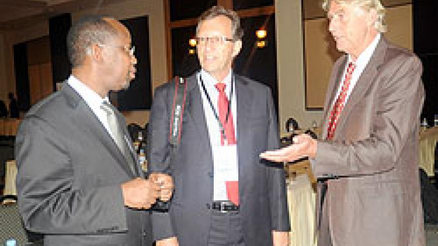 RDB CEO,  John Gara (L) chats with Morten Svelle from the Norwegian Embassy (C) and the Norfund Investment Director for Eastern Africa, Per Emil Lidoe, yesterday. The New Times / J.Mbanda