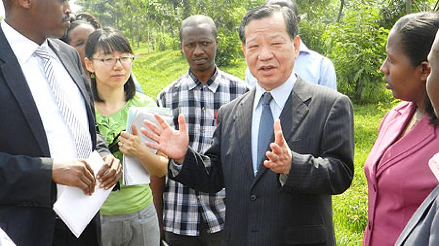 Japan's Ambassador to Rwanda, Kunio Hatanaka, speaking to Kayonza residents about setting up a roadside station in Mukarange. The New Times / S. Rwembeho.