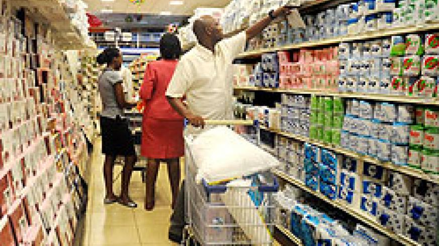 Shoppers select items from a Kigali store. Most of the goods are imported from the region.  The New Times / File.