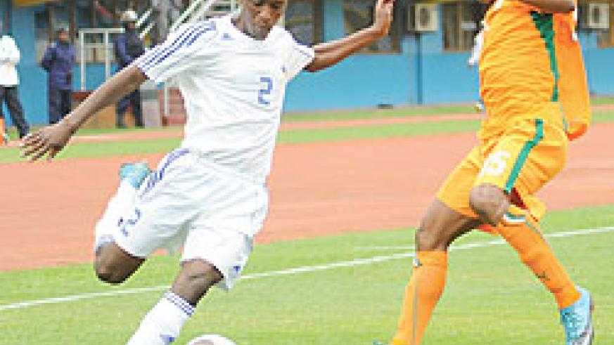 Rusheshangoga takes on an Ivory Coast player during the 2011 CAF U-17 Africa championship. The youngster is set to undergo trials in Belgium. The New Times/ File.