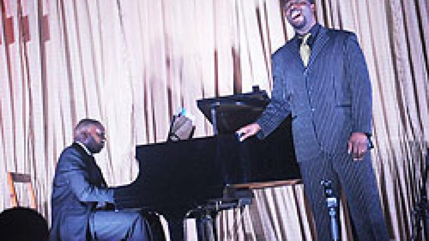 Jacques-Greg Belobo on stage with his piano accompanist Simon Pierre Ndoyé.