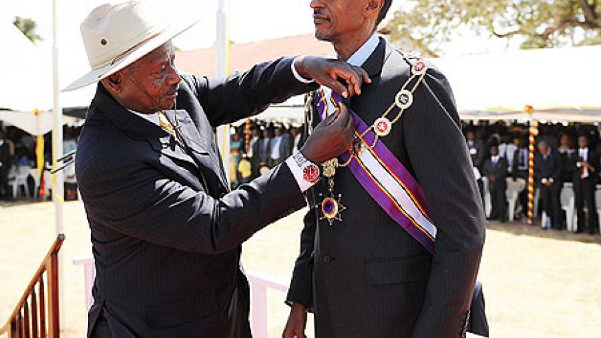 President Kagame being decorated by Ugandan President Yoweri Museveni during the NRM's 26th Anniversary celebrations in Kapchorwa yesterday. The New Times/Village Urugwiro.